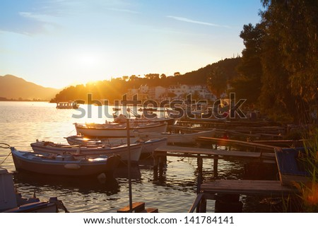 boats at sunset, beautiful view of Poros island in Greece