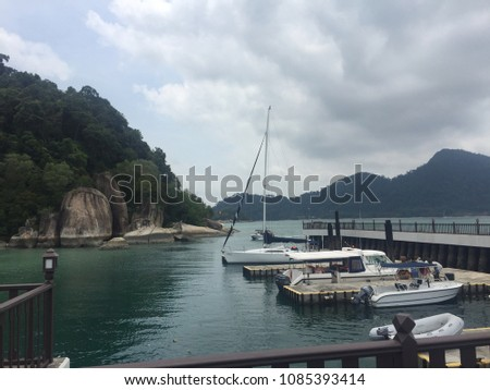 boats at the jetty. the jetty belongs to the private island resort in Malaysia #1085393414