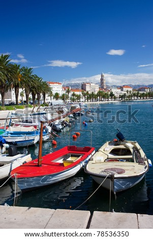 Boats docked at port and city waterfront in Split, Croatia