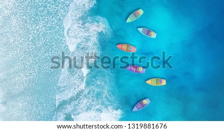 Boats from air. Aerial view on sea in Turkey. Summer seascape with clear water in sunny day. Top view of boats from drone. Summer seascape from air. Travel - image