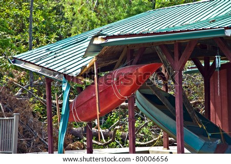 Boats hanging in a boathouse after a storm.