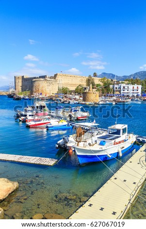 Boats in a port in Kyrenia (Girne) with castle in the background, Cyprus