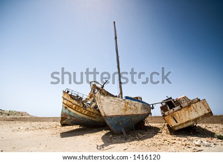 Boats in a scrapyard on a hot day - horizontal - place for text on top