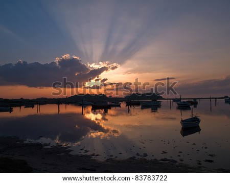 Boats in an amazing seascape of magical sunset - perfect nature boating background