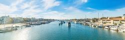 Boats in Balboa island harbor on a sunny day. Newport Beach, Orange County. Southern California, USA