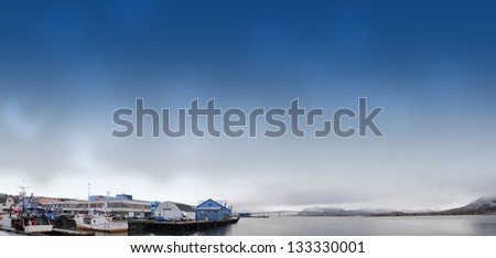 Boats in bay and houses, village on coast
