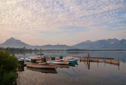 Boats in lake Hopfensee near Hopfen am See in the German state Bavaria