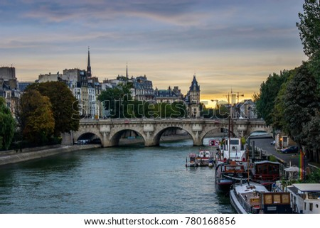 Shutterstock Boats in sena river on pier, sunrise