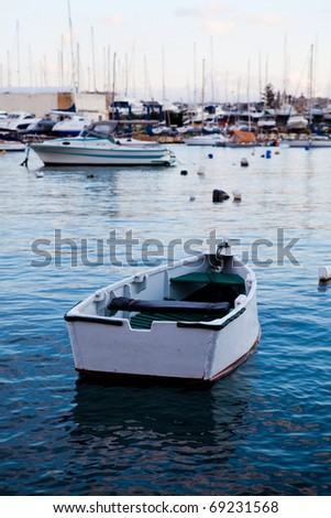 Boats in Sliema harbor, Malta. Beautiful sunset.