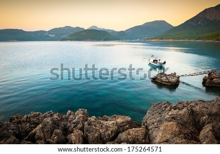 boats in the bay at sunset