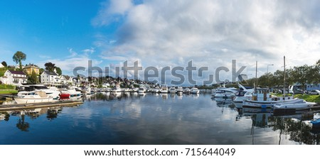 Boats in the bay of Stavanger in summer, panoramic view #715644049