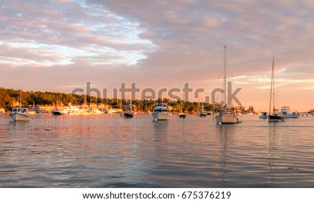 Boats in the calm and beautiful Boothbay Harbor at dusk