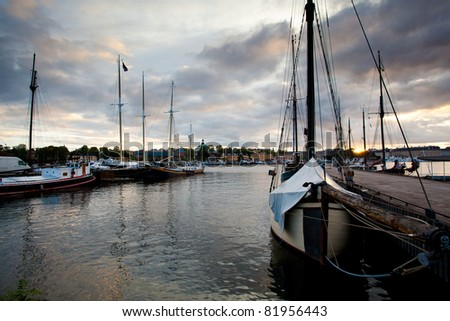 Boats in the harbor at sunset in Stockholm, Sweden