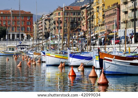 Boats in the port of Nice in southeastern France,department Alpes-maritimes, with colorful buildings in the background