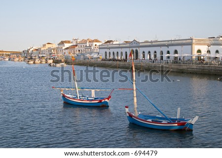 Boats in the sea channel of Tavira, Algarve, Portugal