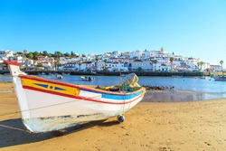 Boats in warm sunset light on the beach in Portimao, Portugal