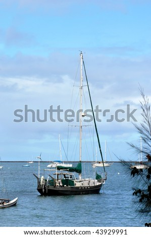 Boats lay at anchor in Hilo Bay on the waters of the Big Island of Hawaii.