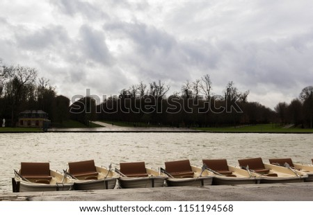 Boats line up on the lake in the garden of Versailles Palace #1151194568