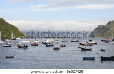 Boats lying in the harbor of Portree on the Isle of Skye - stock photo