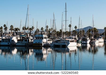 Boats moored in bay at the Chula Vista Bayfront park with mountain peak in the background. #522260560