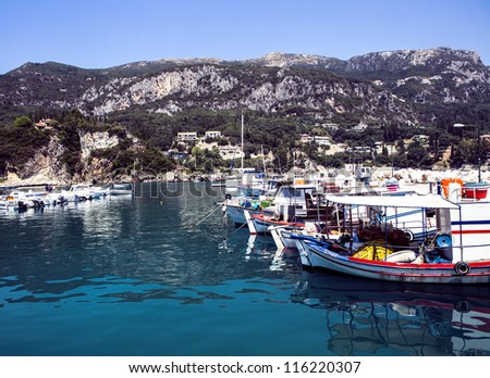 Boats moored in harbour near Corfu, Greece