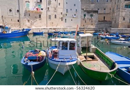 Boats moored in Monopoli old port. Apulia. - stock photo