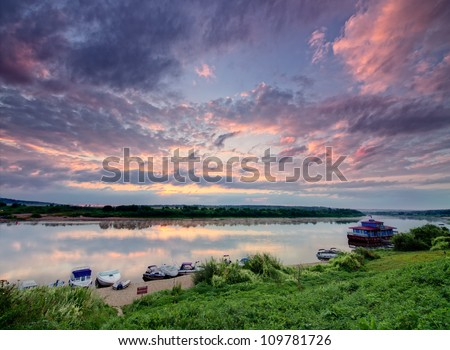 Boats on a riverside at sunrise. View from above.