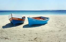 Boats on a secluded beach in Paternoster, South Africa
