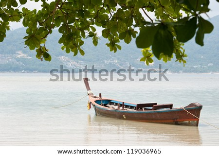 Boats on a Thai beach.