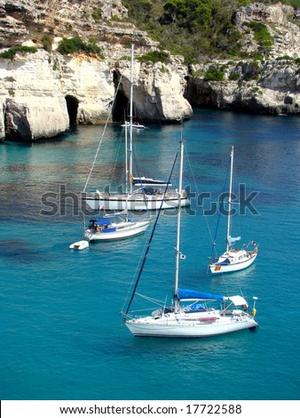 Boats on bay of Cala Macarella Menorca