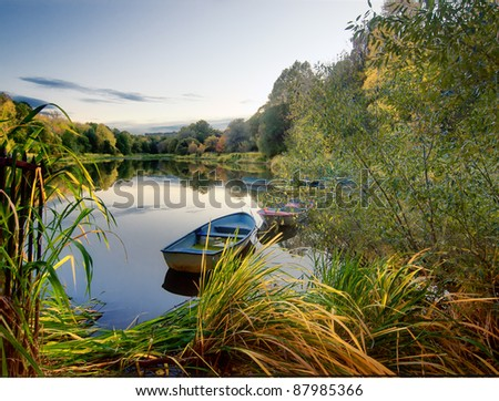 Boats on lake. Autumn view of the park.