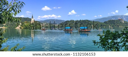 Boats on Lake Bled, with Bled Island and Bled Castle in the background