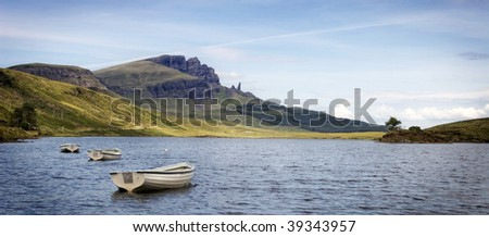 Boats on Loch Fada with Old Man of Storr in the background on Isle of Skye, Scotland