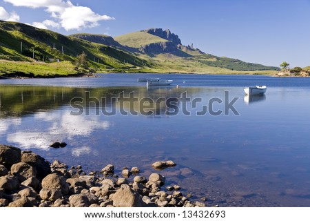 Boats on Loch leathann with the old man of storr in the background