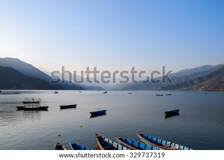 Boats on Pokhara Fewa Lake in Nepal. #329737319