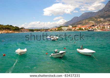 boats on restless adriatic sea in makarska, croatia