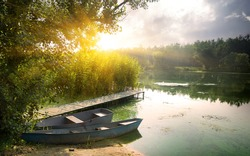 Boats on river at beautiful summer sunrise