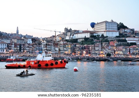 Boats on the Douro River in the evening