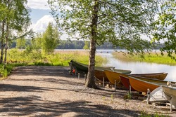 Boats on the shore of the lake. Fishing. Summer landscape. Summer background. Camping. Rest in your own country. High quality photo