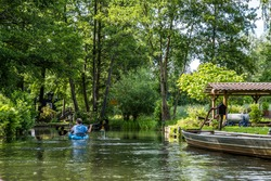 Boats on the water canal in biosphere reserve Spree forest (Spreewald) in the state of Brandenburg, Germany