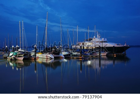 boats parking in jetty at twilight time