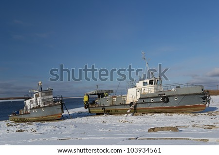 Boats standing on Irtysh river bank, near Khanty-Mansiysk