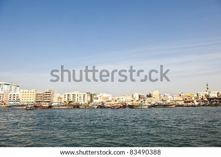 Boats used for living, transporting of goods, and fishing, moored in Dubai creek. - stock photo