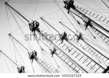 Boats yachts masts. Abstract architecture. Lines and geometry. Perspective. Black and white photography. Sea theme.  #1025267524