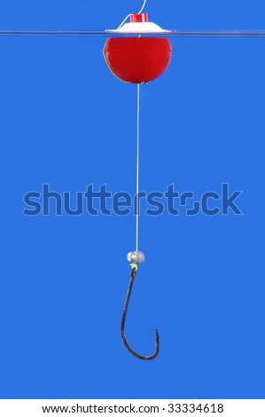 Bobber, line and hook isolated on blue background