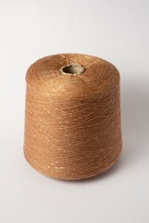 bobbin of yarn on a white background. Side view.Textile reel on isolated white background.