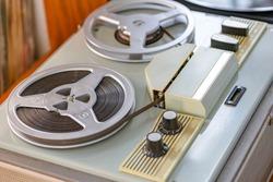 Bobbin tape recorder. Reel Bobbin. stock, strip. Old Film reel, bobbin, spool against a dark . close up.