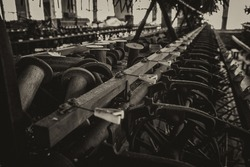 Bobbins and machines at an abandoned silk mill.