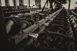 Bobbins and machines at an abandoned silk mill.