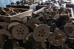Bobbins and more bobbins at an abandoned silk mill.